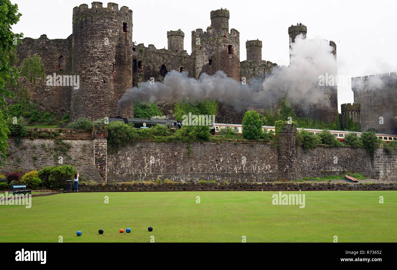 Royal Scot Steam Train going past Conwy Castle. Image taken in June 2018. - Stock Image