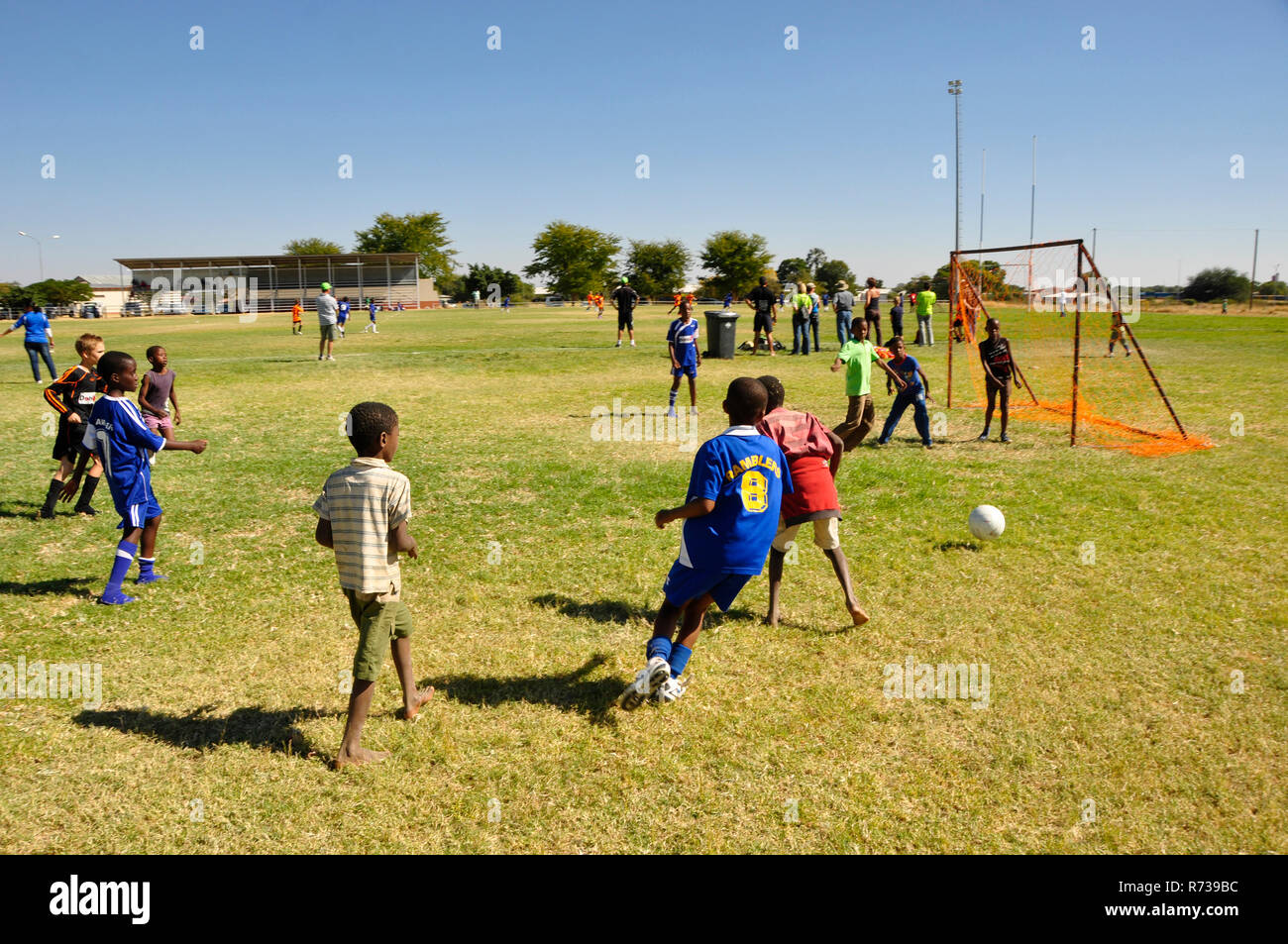 Namib schoolkids playing football at a competition in Okahandja. - Stock Image