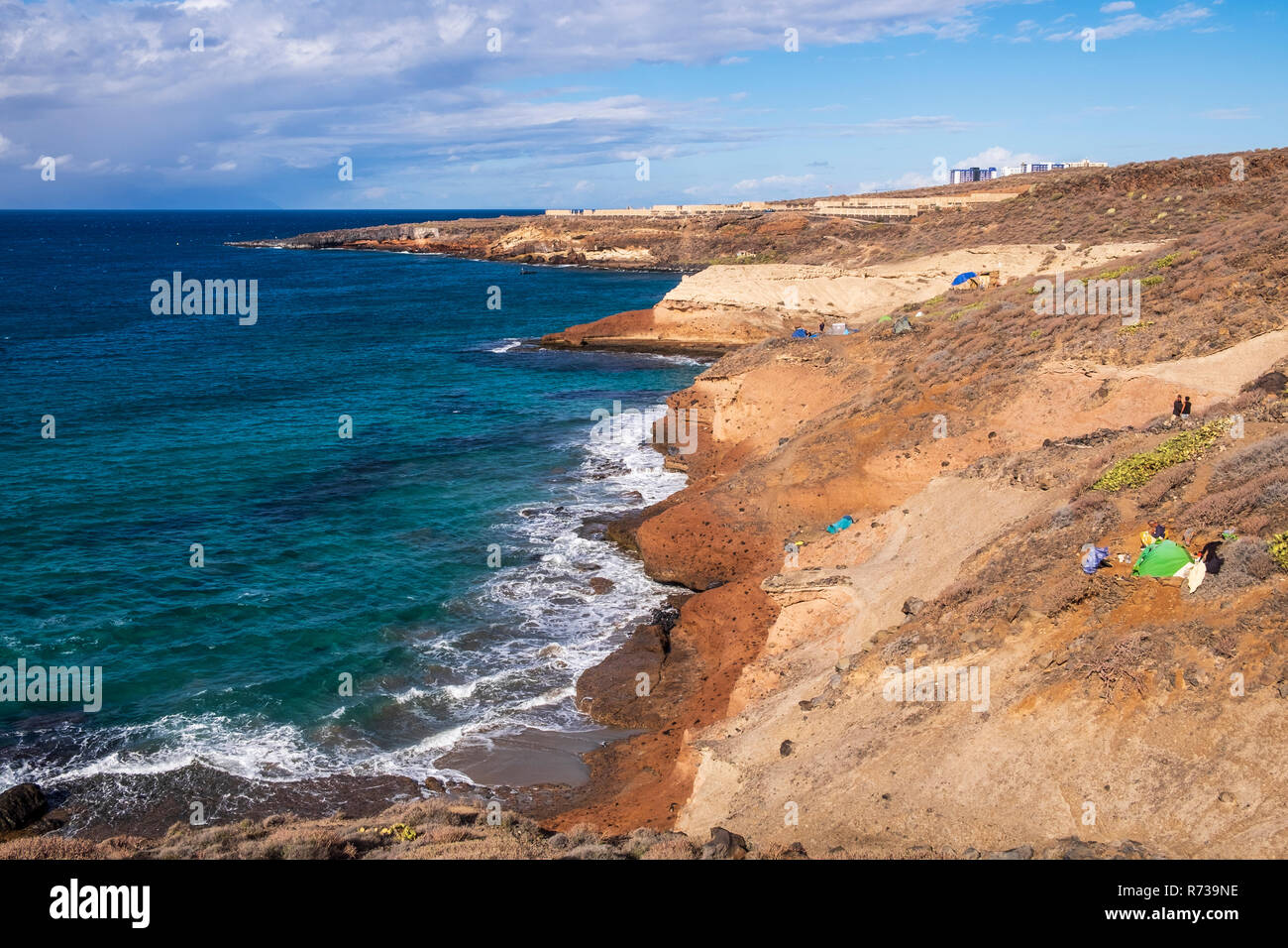 Undeveloped section of coastline in Costa Adeje looking towards Playa Paraiso and the Hard Rock hotel visible over the ridge, Tenerife, Canary Islands - Stock Image