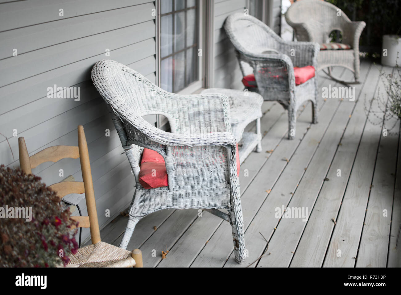 Wicker chairs on a gray porch. Stock Photo