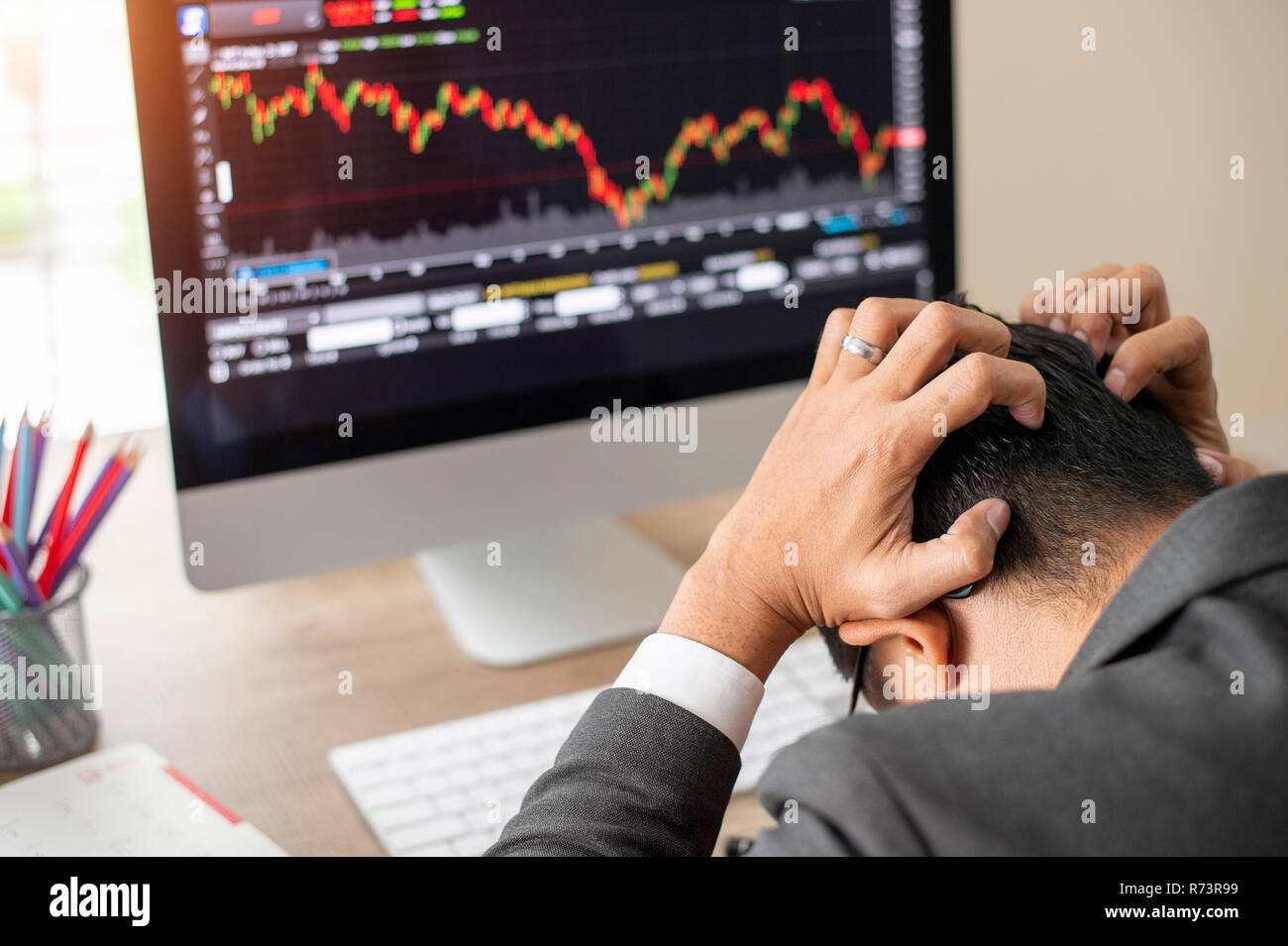 Asian businessman is disappointed from losing in business situation.Bad investment or economic crisis concept. - Stock Image