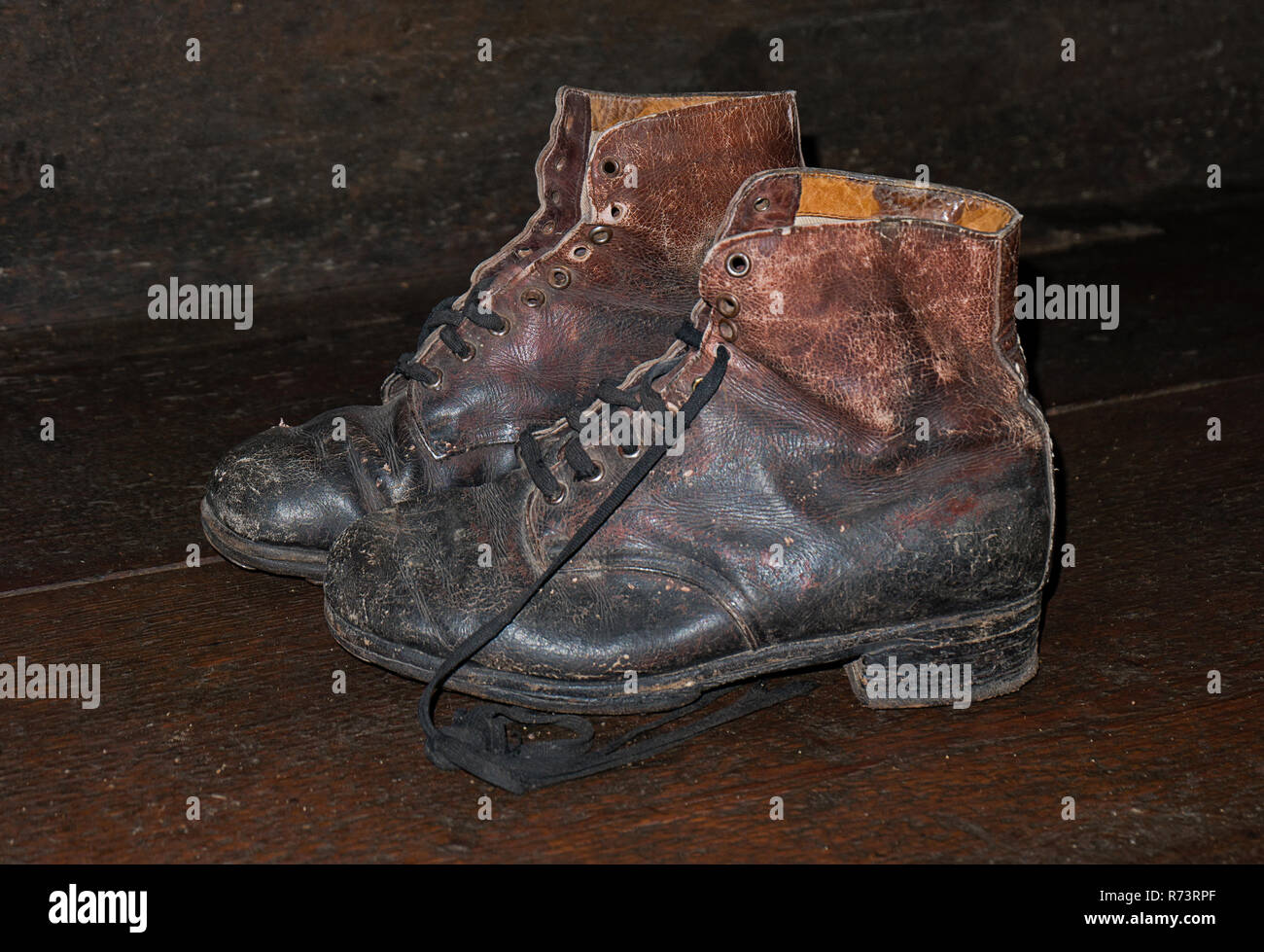worn out working shoes leather antique - Stock Image