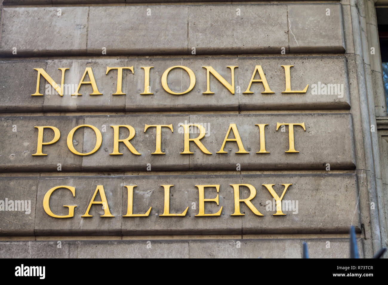 National Portrait Gallery, gold sign, brass sign, sculptures pieces of art tourist attraction, things to do London UK britain british - Stock Image