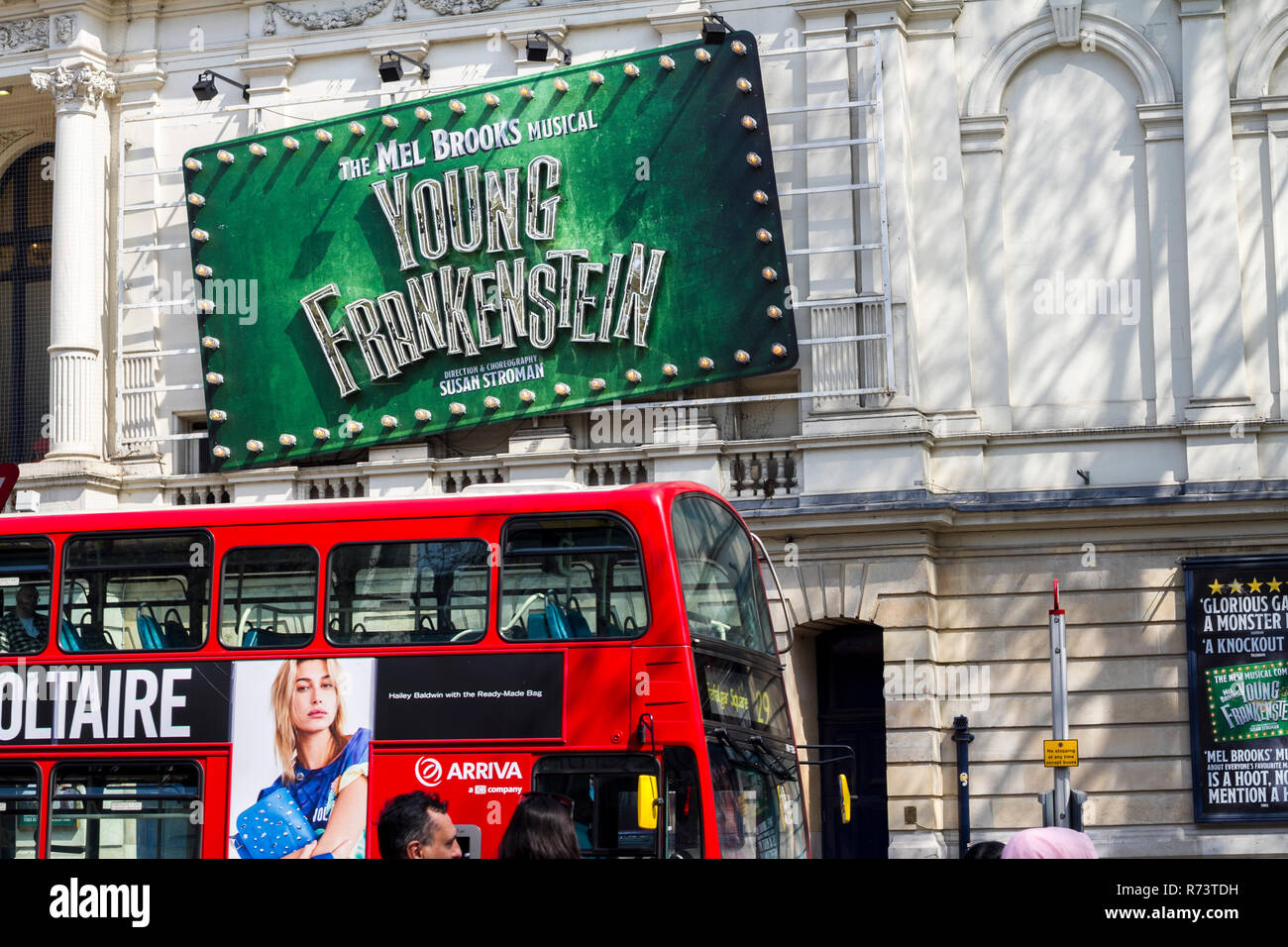 Londons Westend noticeboard billboard typically british concept red bus london postcard young frankenstein musical theatre plays travel visiting londo - Stock Image