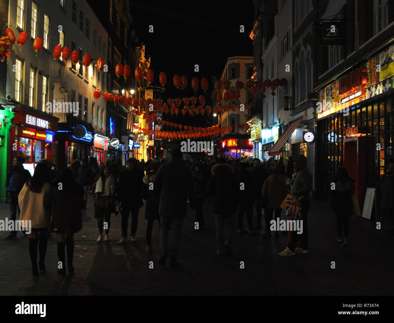 Pedestrians on Wardour Street, Soho, London, UK. - Stock Image