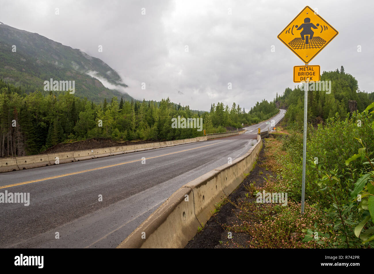 Metal Bridge Deck warning sign by the Burrage River in British Columbia, Canada - Stock Image