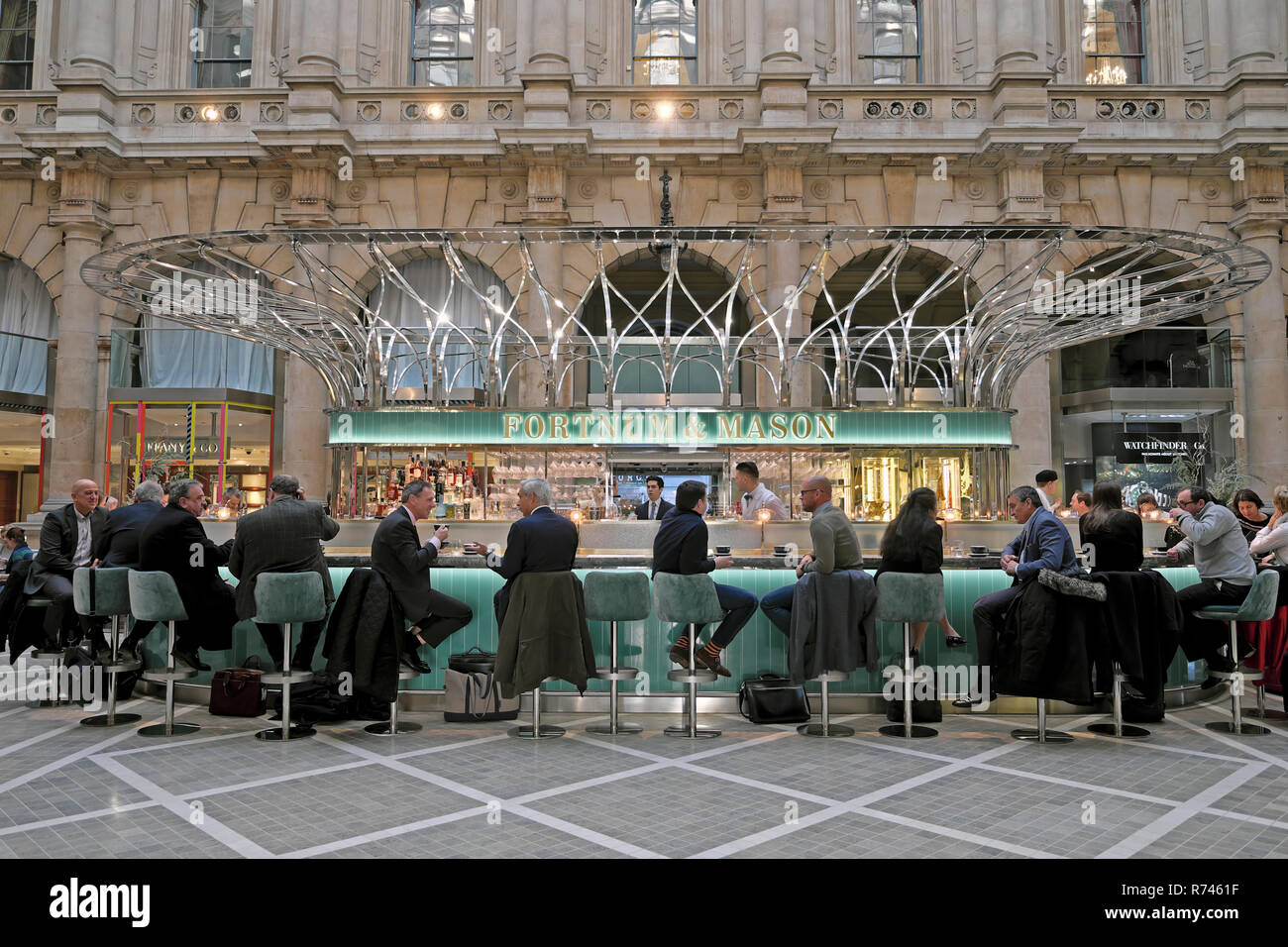 Fortnum & Mason Christmas tree outside the Royal Exchange and Bank of England with a street view of Mansion House City of London UK  KATHY DEWITT Stock Photo