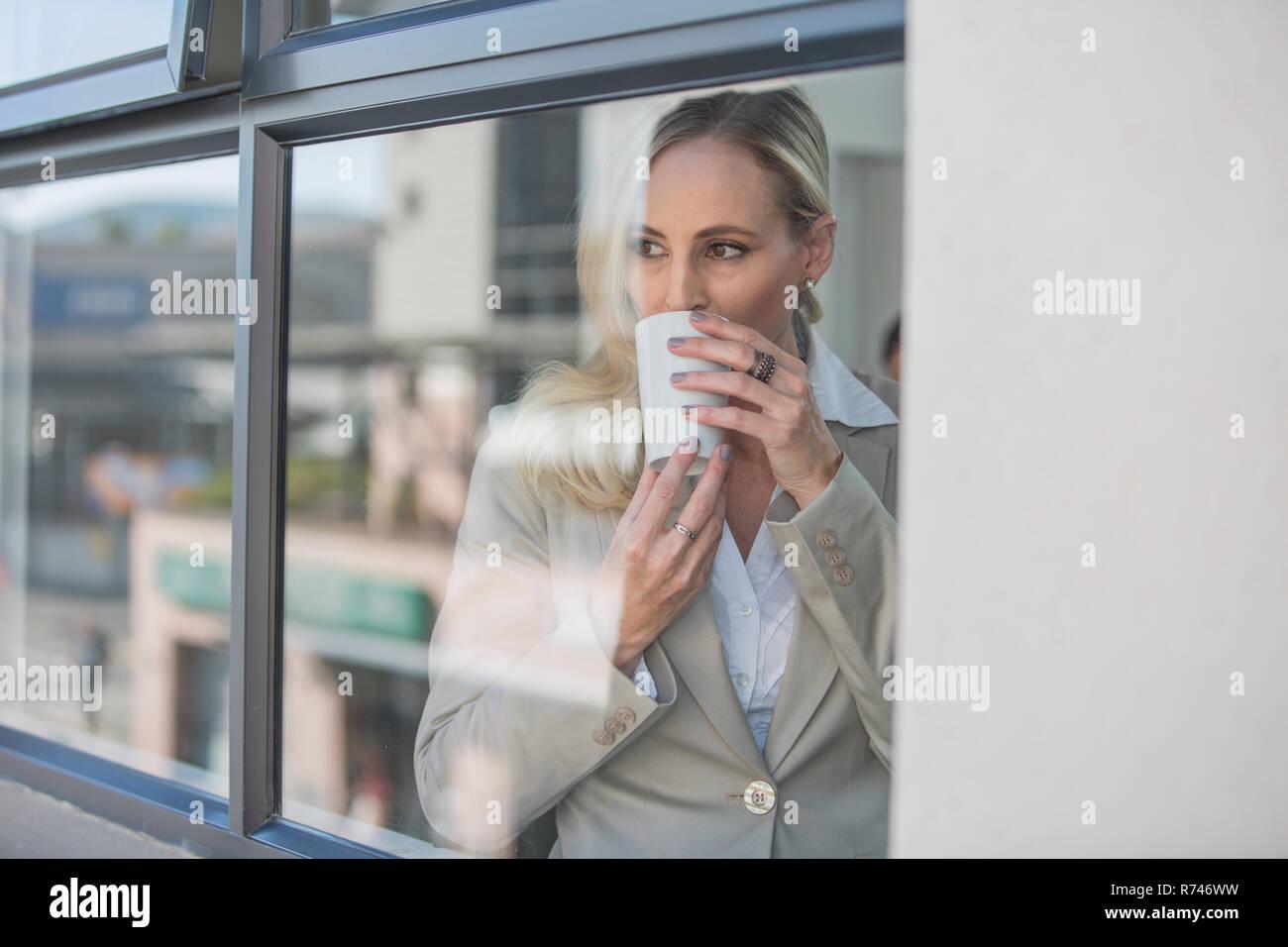 Take Break Coffeebreak : Businesswoman taking coffee break in office stock photo