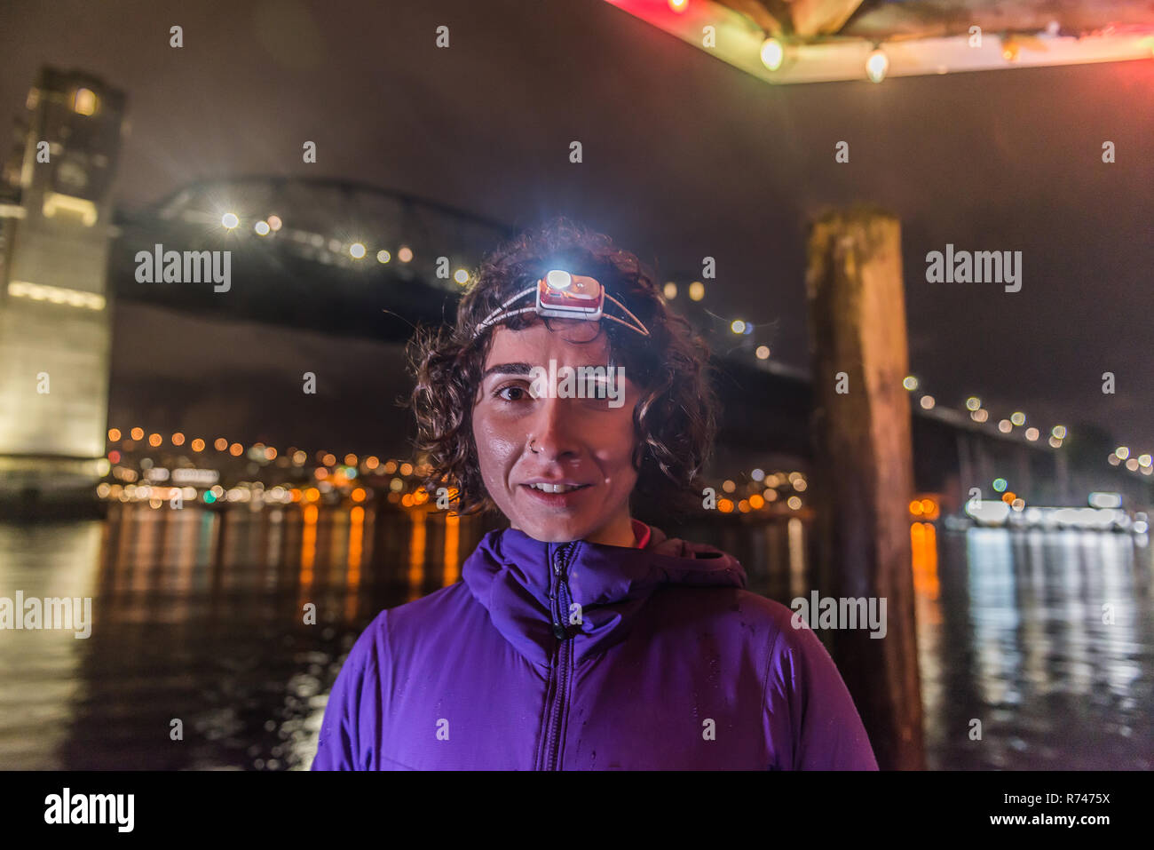Runner with headlamp in urban North Vancouver, Canada - Stock Image