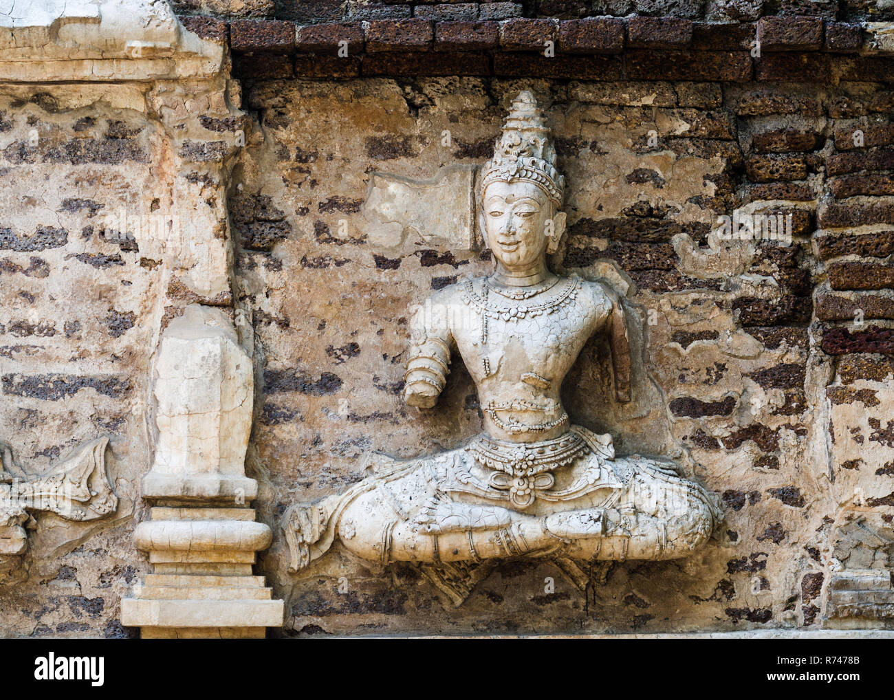 Stucco reliefs on the facade of Maha chedi, Wat Chet Yot, Chiang Mai, Thailand - Stock Image