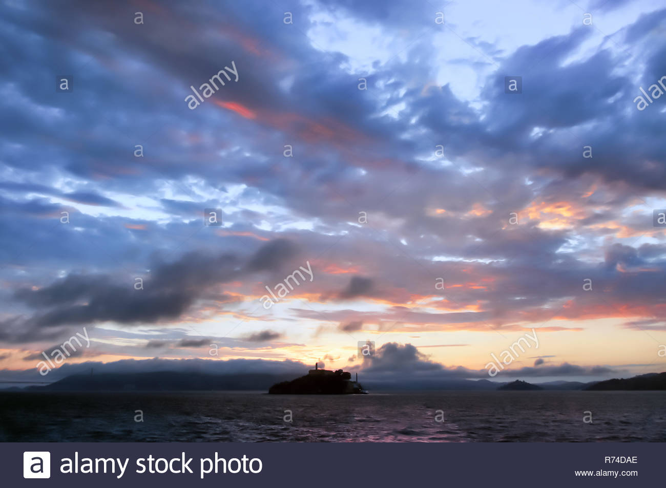 Alcatraz Island Sunset as seen from a Cruise Boat - Stock Image