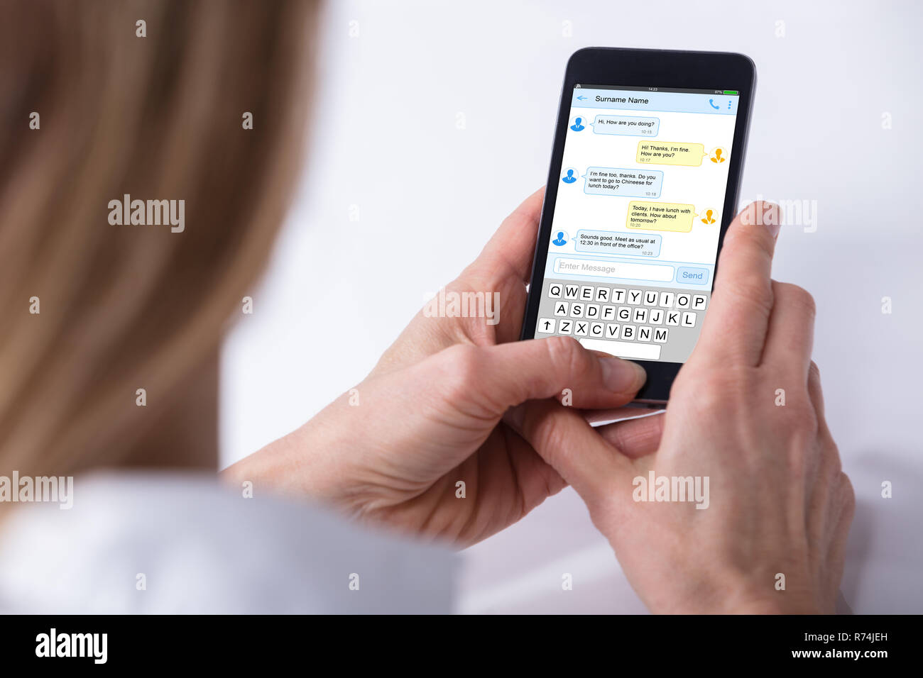 Person Sending Text Message From Smartphone Stock Photo