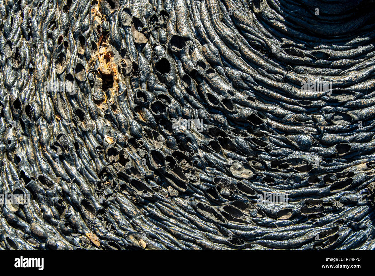 Drawings and forms on the lava flow of the island Santiago in the Galapagos, Ecuador - Stock Image