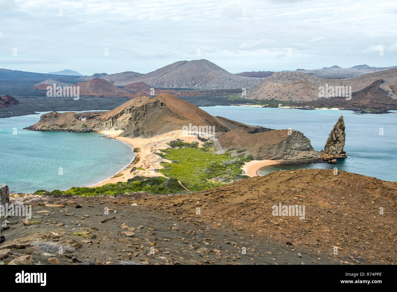 Panorama on the lava pinnacle and Santiago Island seen from the summit of Bartolome Island crater, Galapagos Islands - Stock Image