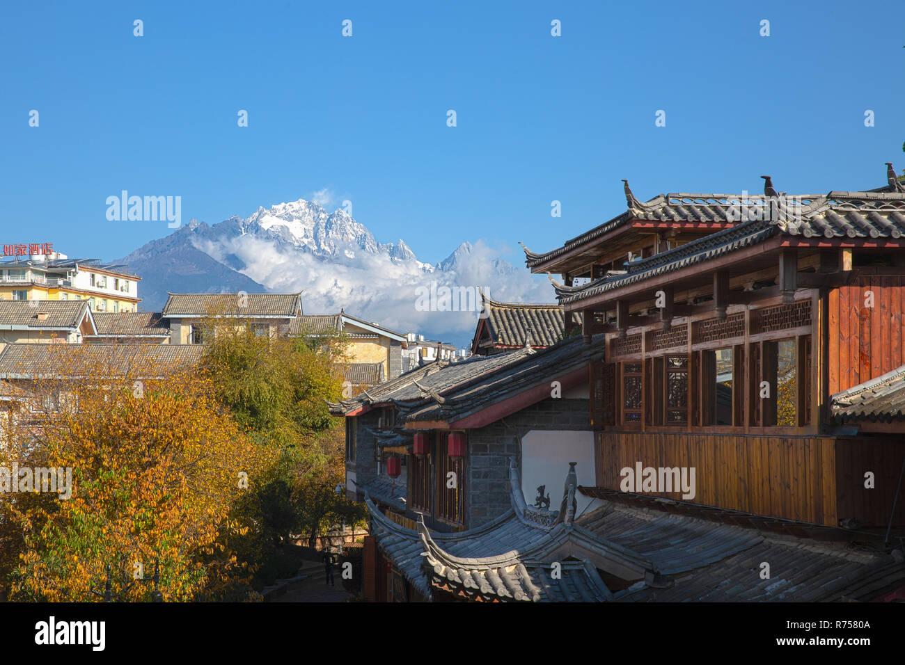 Jade Dragon Snow Mountain from Lijiang Ancient Town ,Yunnan ,China - Stock Image