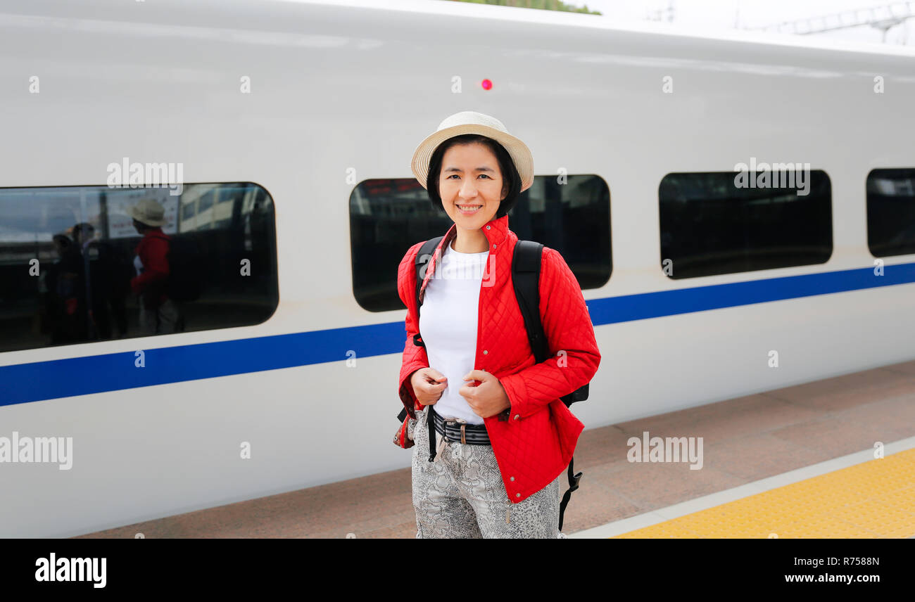 Tourist passengers traveling with China high-speed train is a quick and easy affair due to the high speed rail. - Stock Image