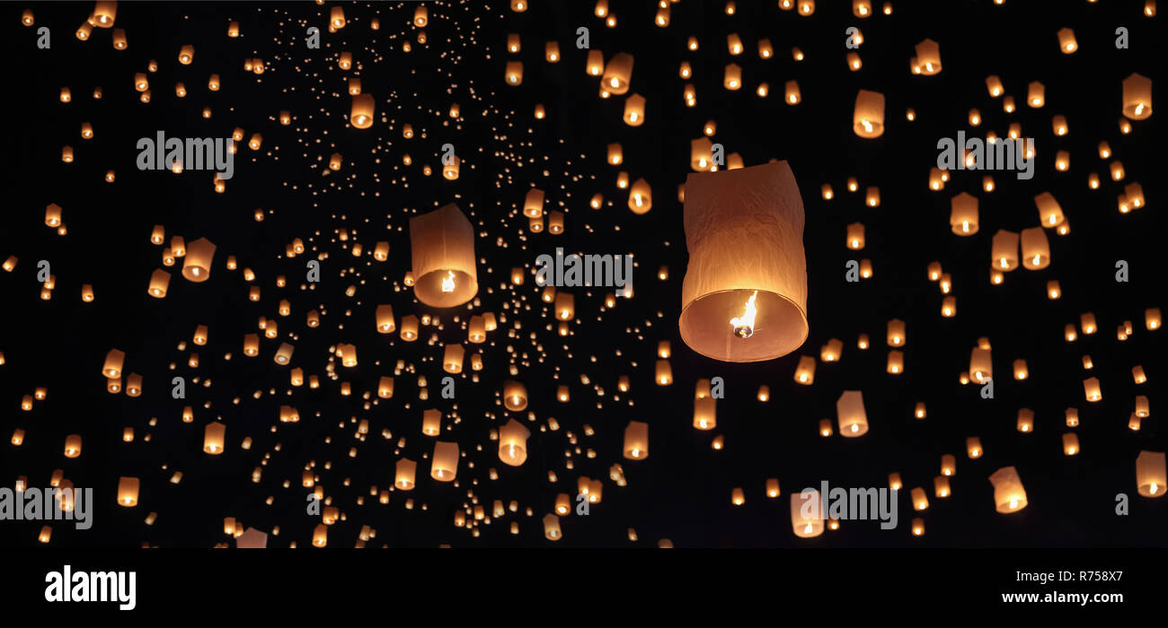Tourist floating sky lanterns in Loy Krathong festival , Chiang Mai ,Thailand. Stock Photo