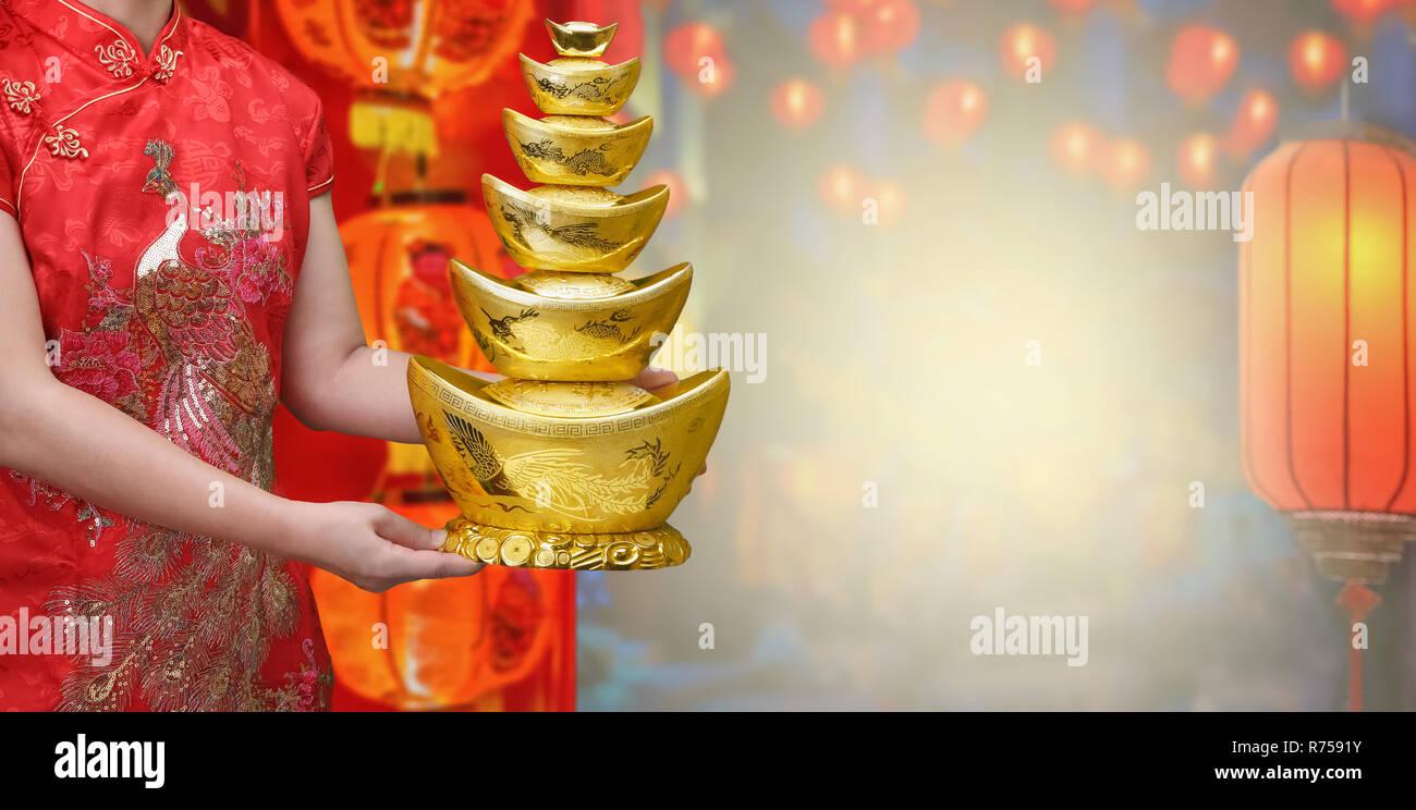 Chinese new year gold ingot (qian) - Stock Image