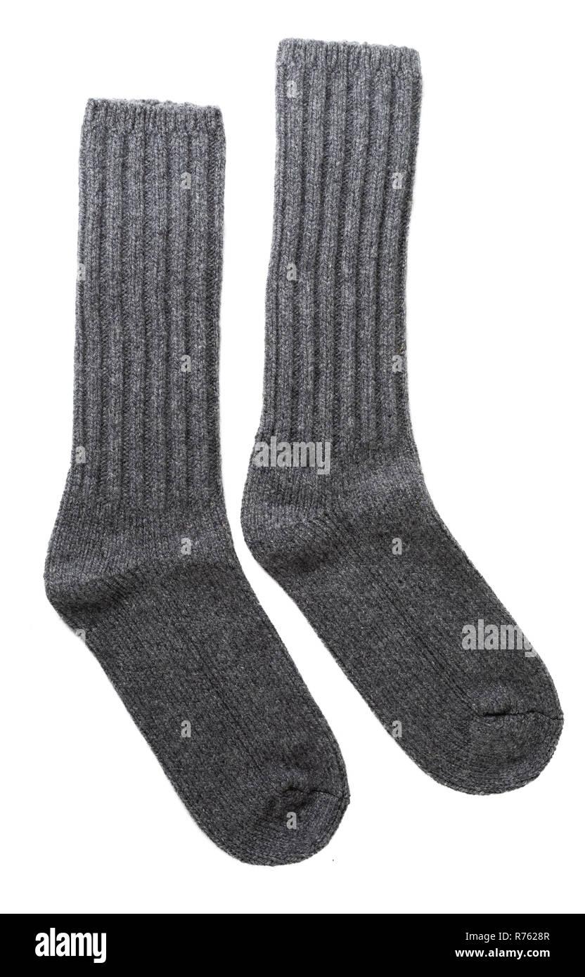 Men's grey wool socks on white. - Stock Image