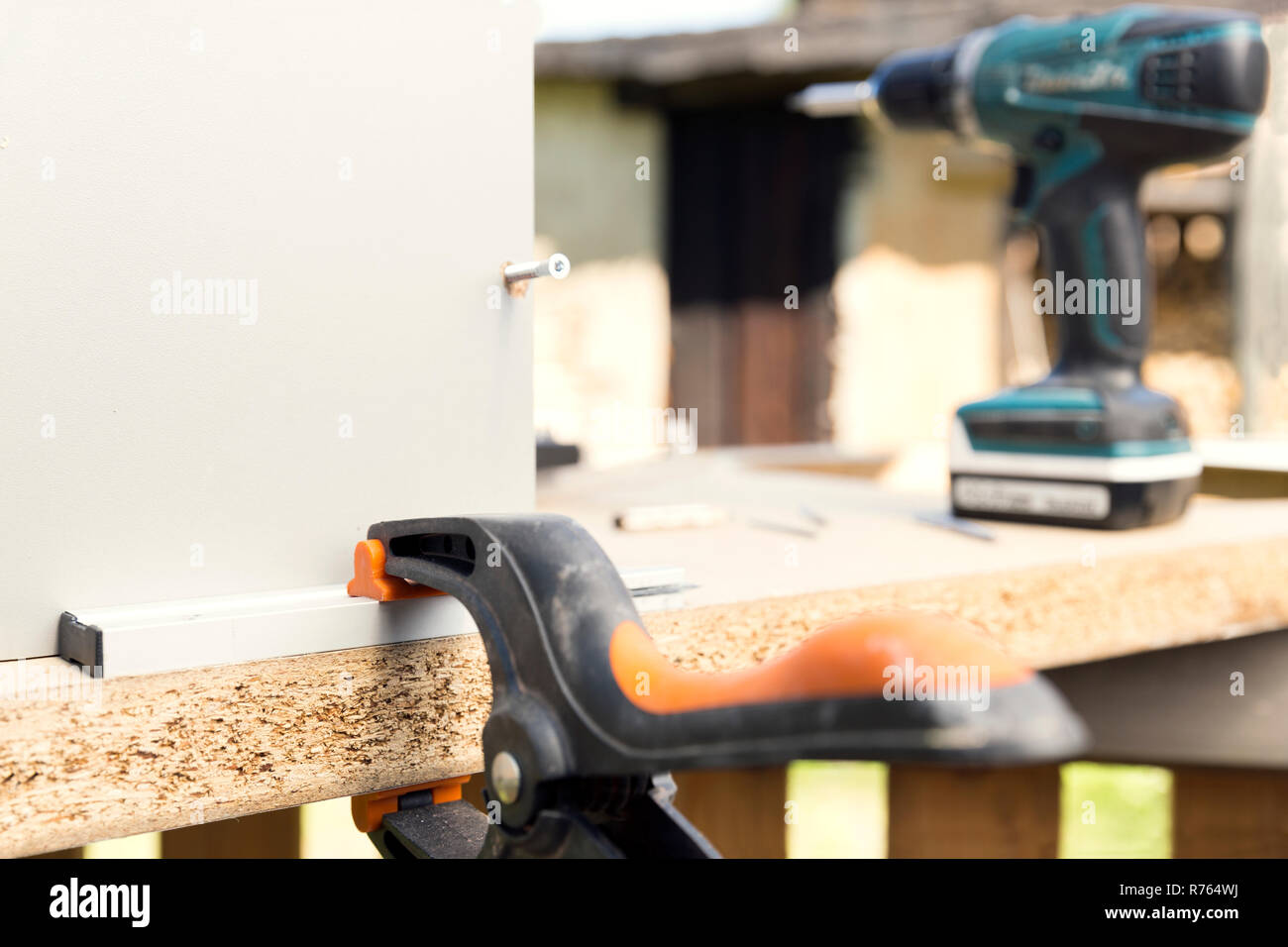 Furniture Assembly Making Of Kitchen Cabinet Using Screwdriver