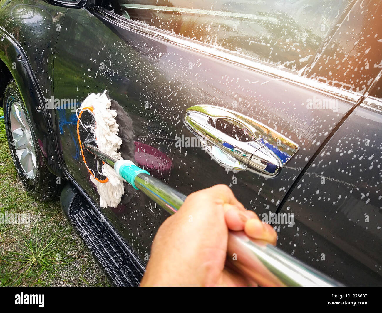 car wash manual / hand worker cleaning washing car with mop