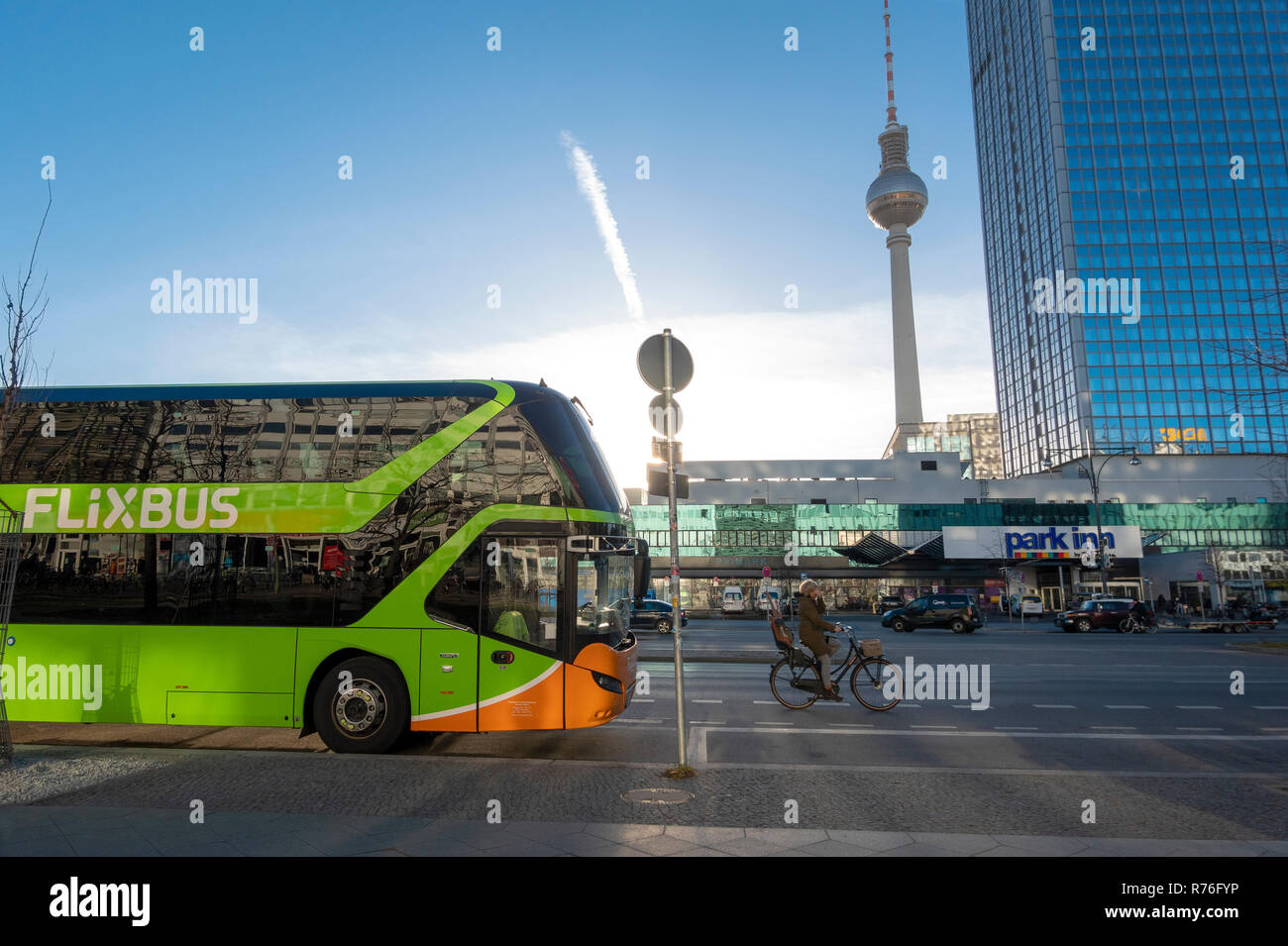 Flixbus long distance bus coach on Alexandersrasse Berlin with the Berlin Television Tower Berlin Fernsehturm Fernseh Tower on Alexanderplatz - Stock Image