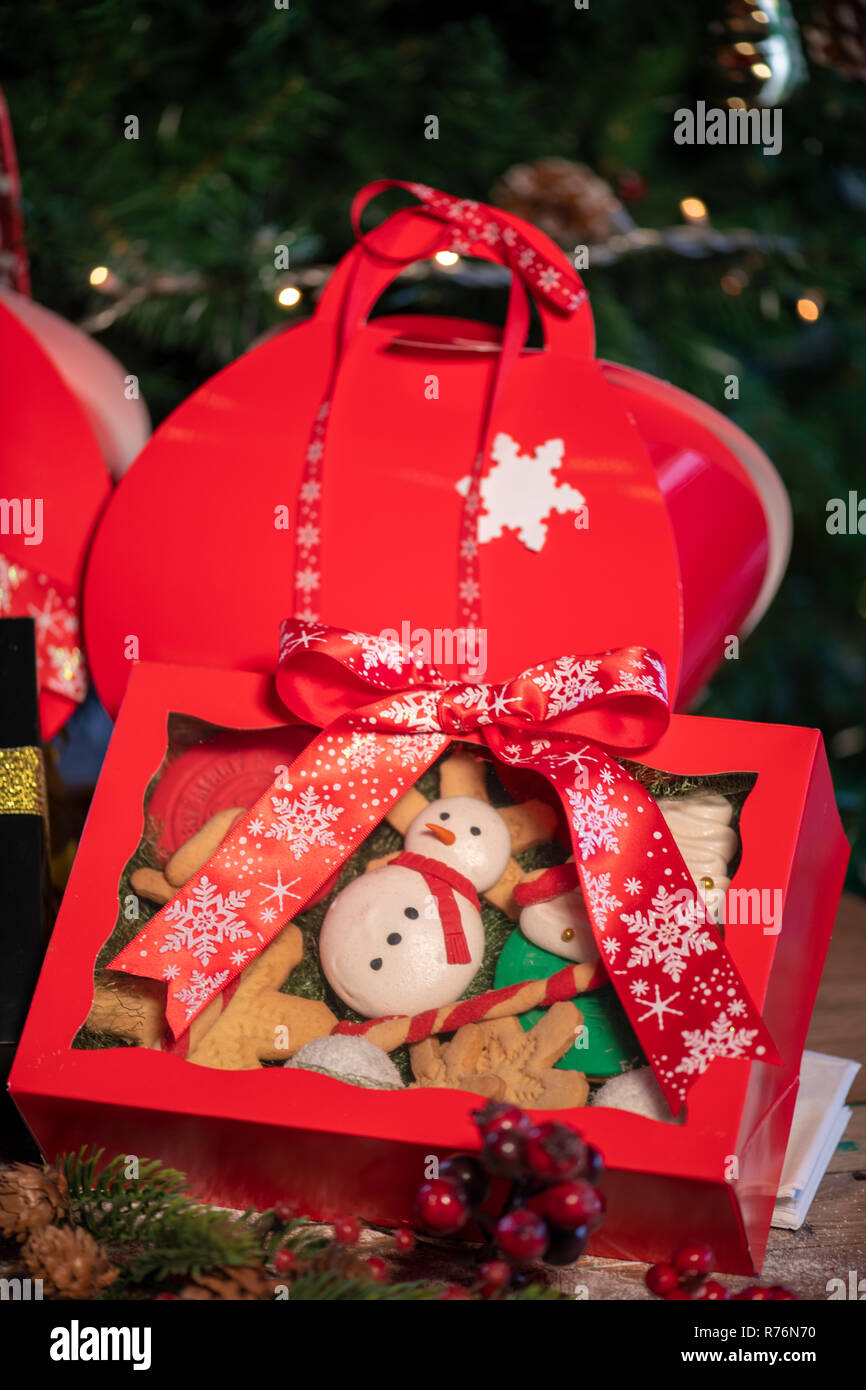 Various Christmas cookie gift boxes with christmas tree and wood background & Various Christmas cookie gift boxes with christmas tree and wood ...