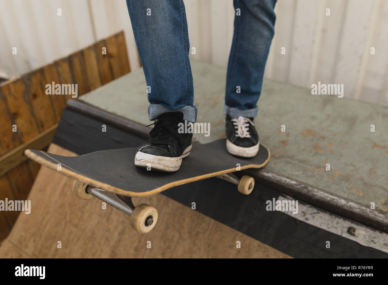 Skate Board Ramp >> Skateboarder Standing With Skateboard On Skateboard Ramp At