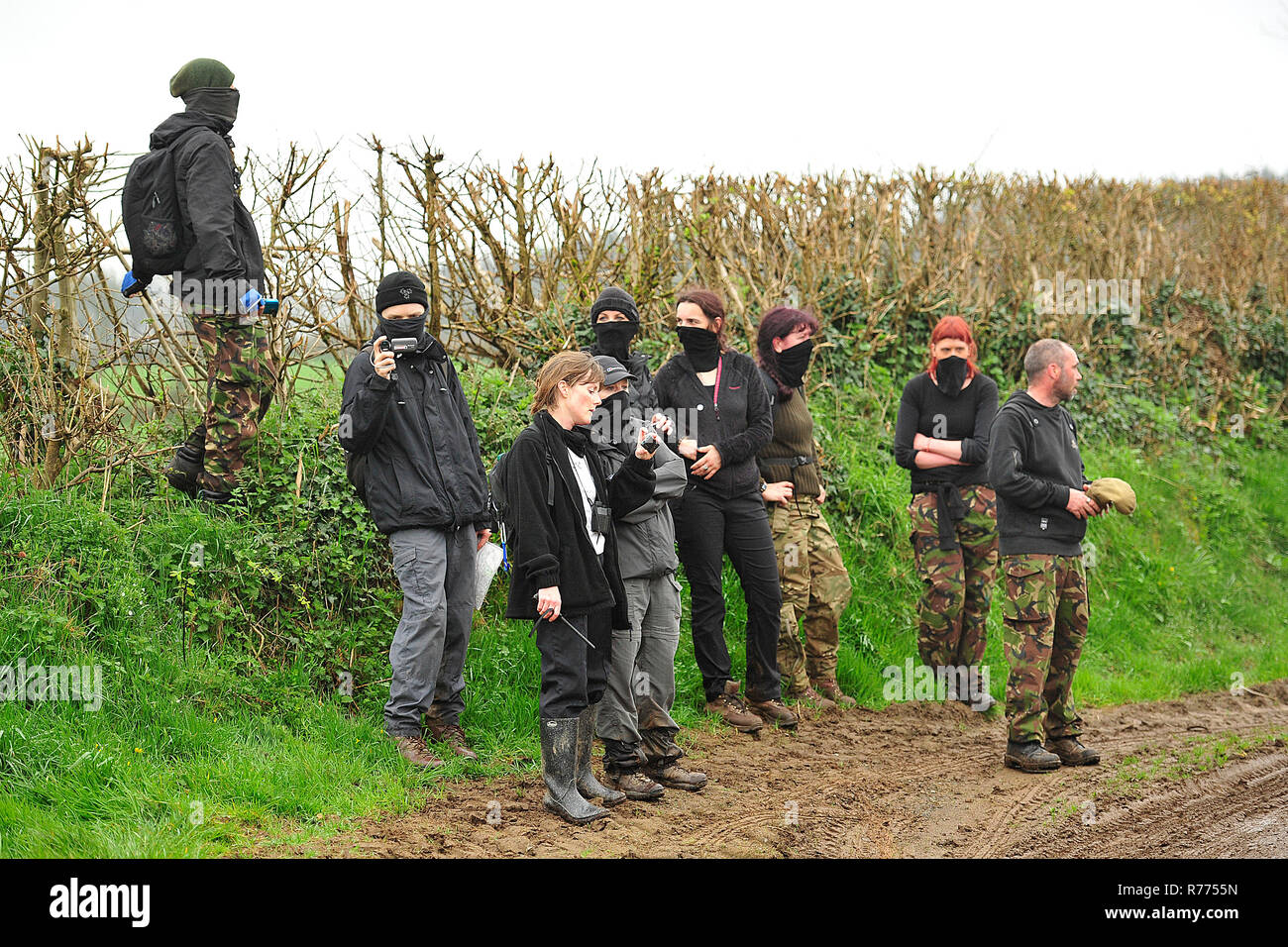 hunt saboteurs videoing and protesting against a hunt - Stock Image