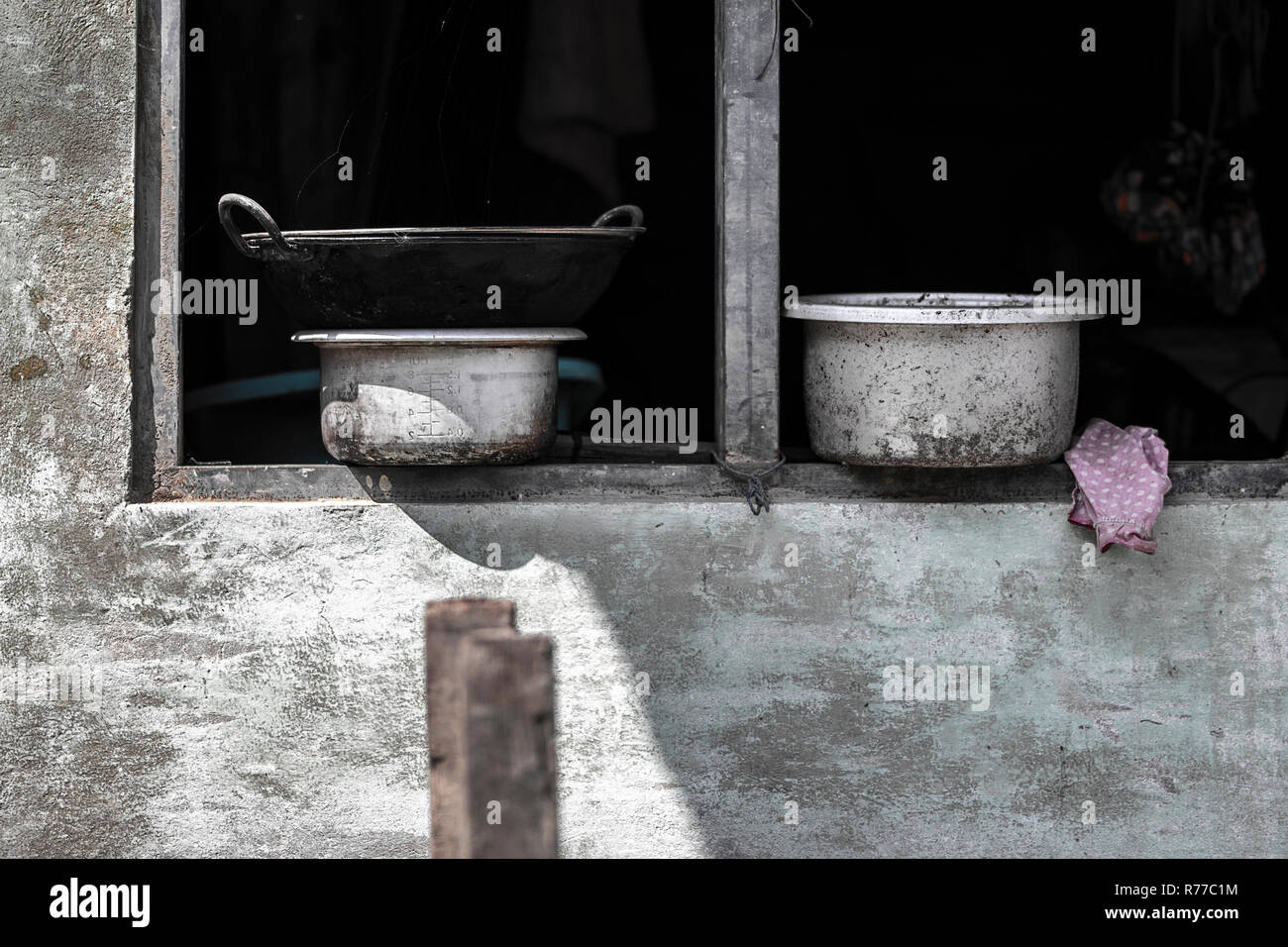 kitchen staff over the window in the myanmar street - Stock Image