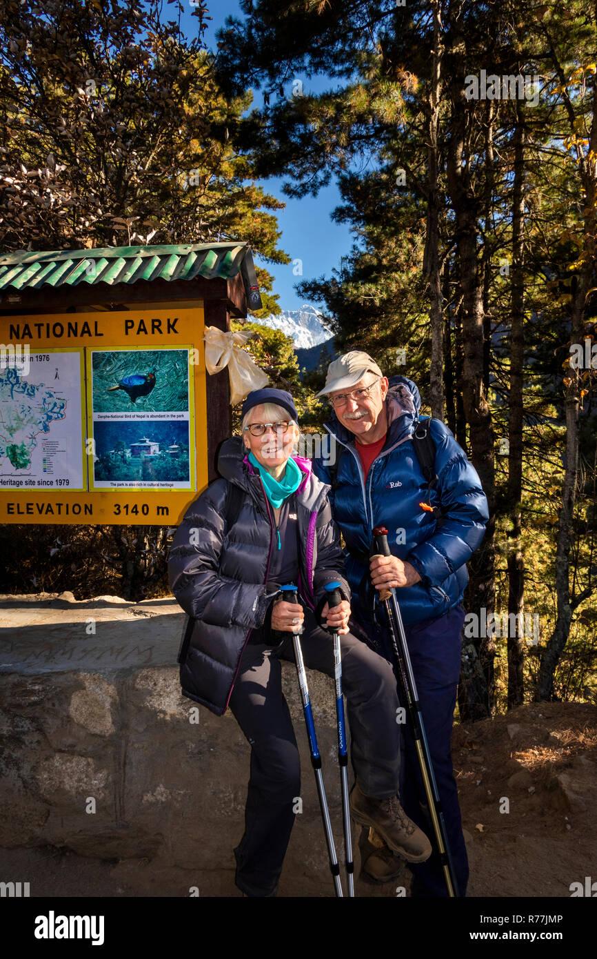 Nepal, Namche Bazar, Sagarmatha National Park, senior tourist couple at Topdanda viewpoint of Everest - Stock Image