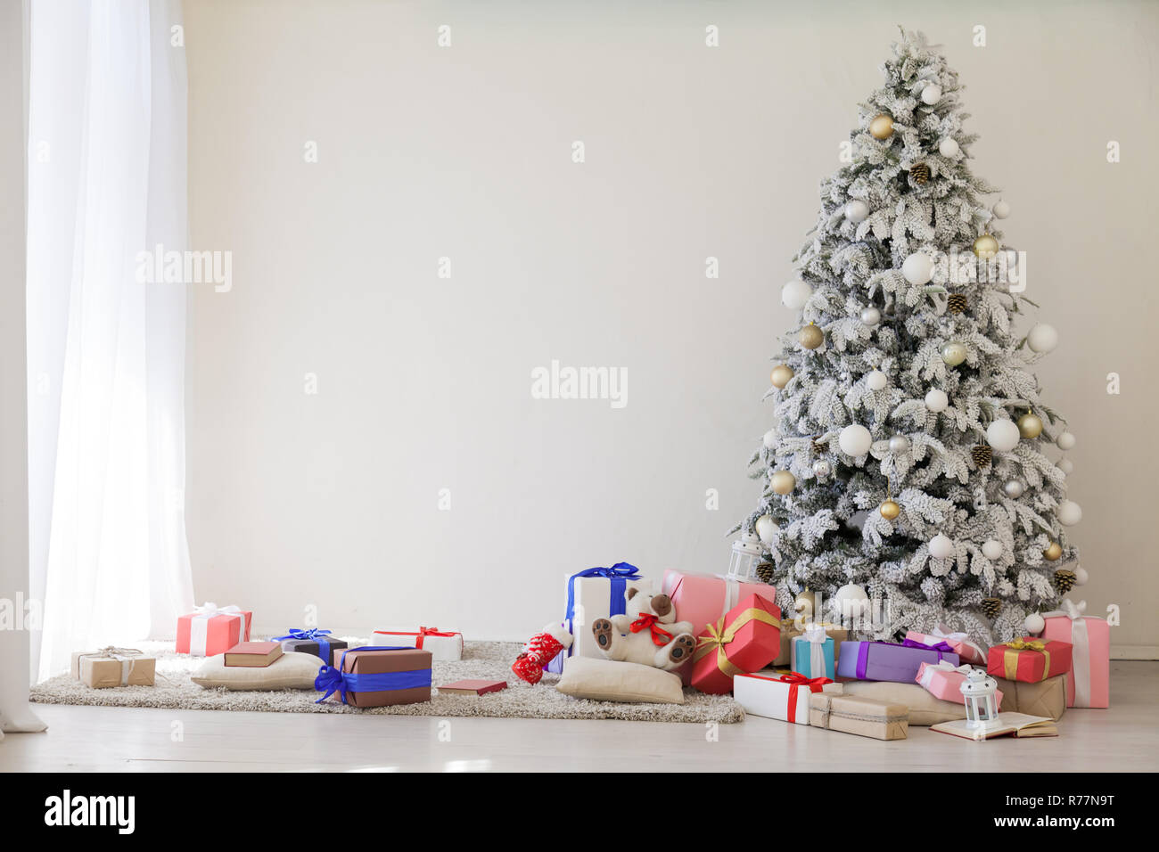 winter Christmas tree Garland lights new year holiday gifts white home decor - Stock Image