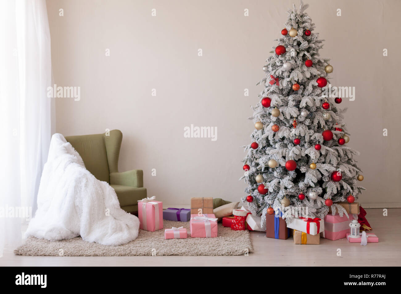 Christmas tree winter new year holiday gifts white home decor - Stock Image