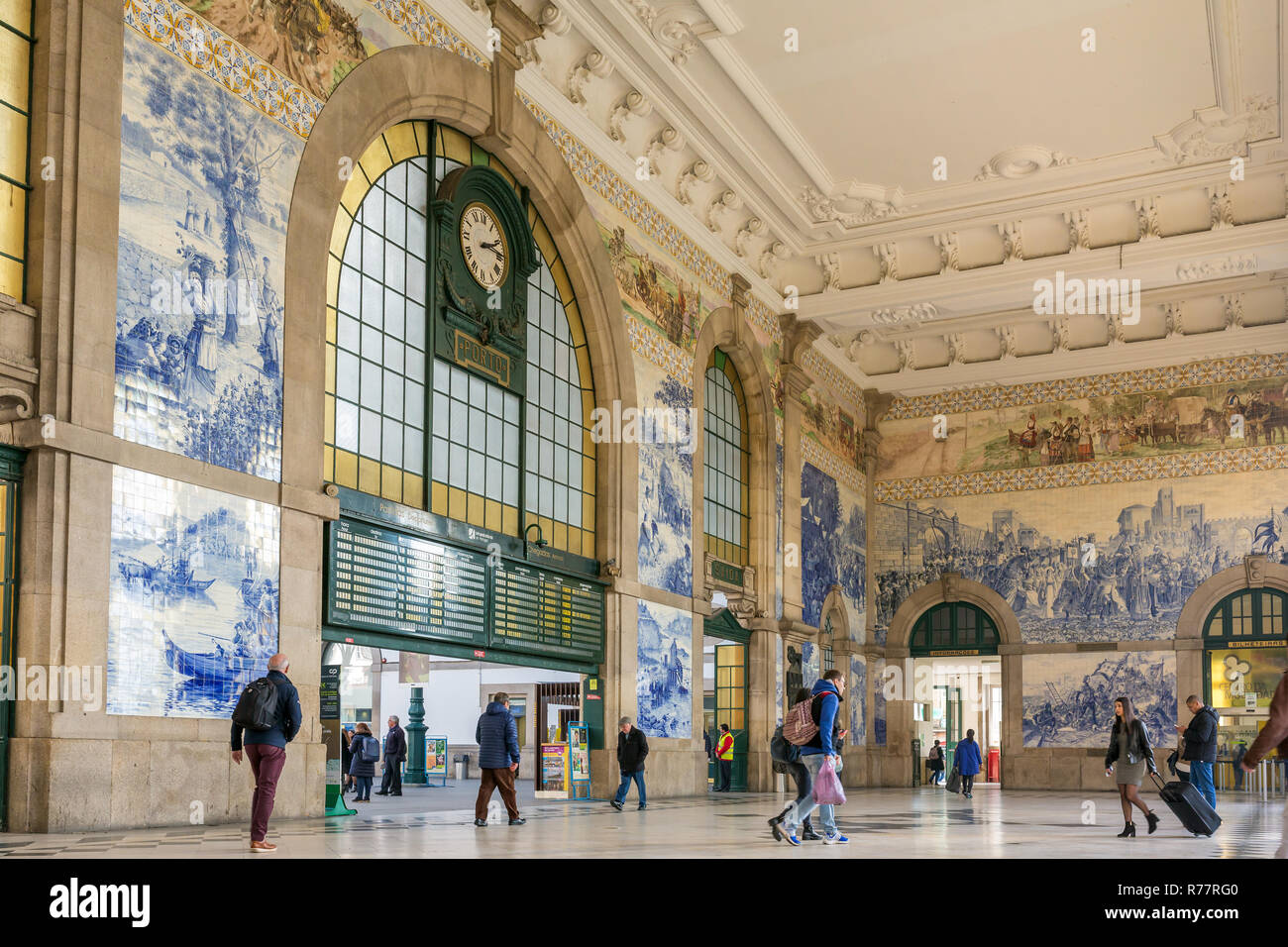 Porto, Portugal - January 12, 2018: People in the vestibule of Sao Bento Railway Station. It is decorated with approximately 20,000 azulejo tiles, dat - Stock Image