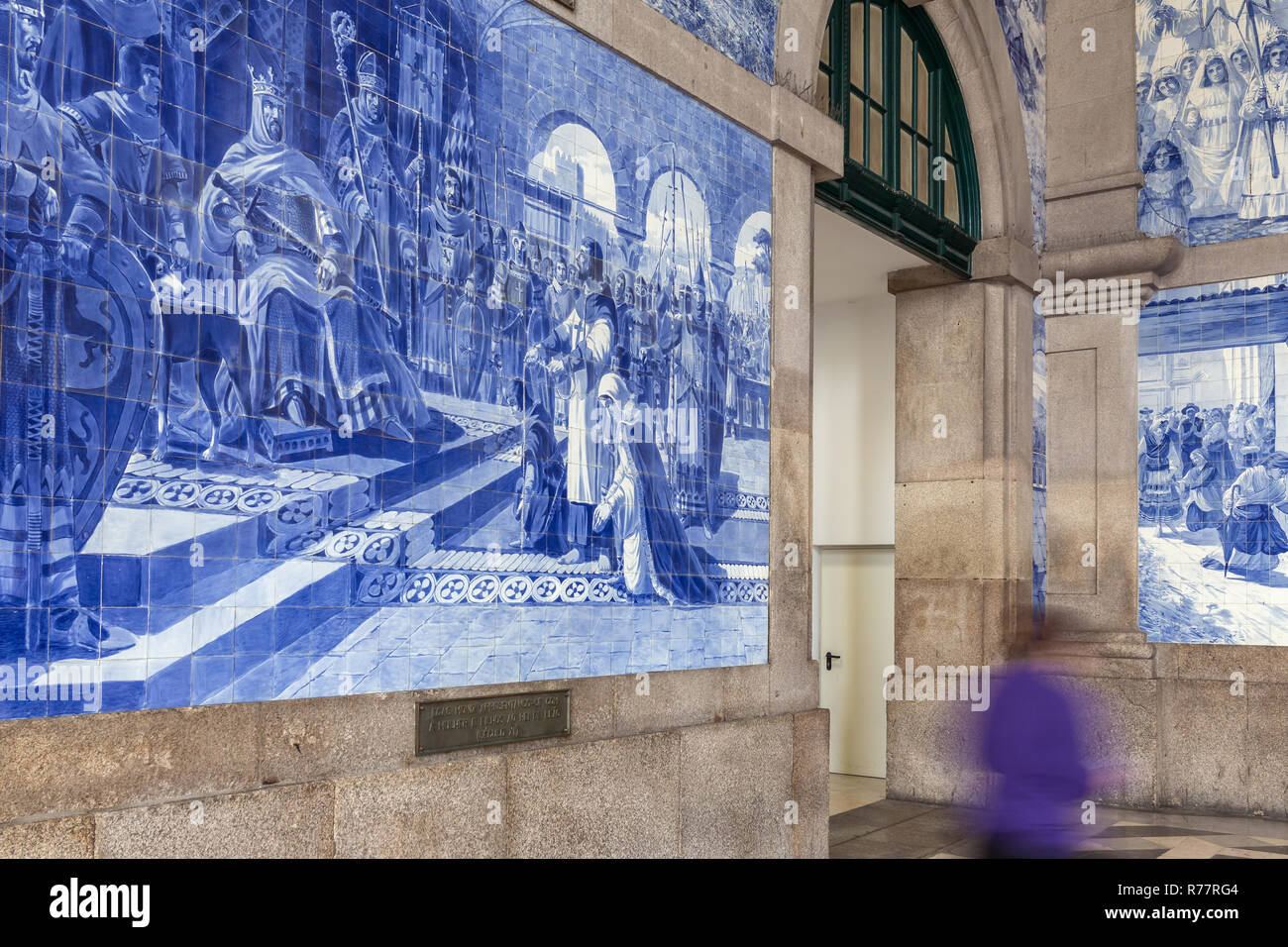 Sao Bento station with traditional portugese tiles Azulejos representing Portugal history, Porto - Stock Image