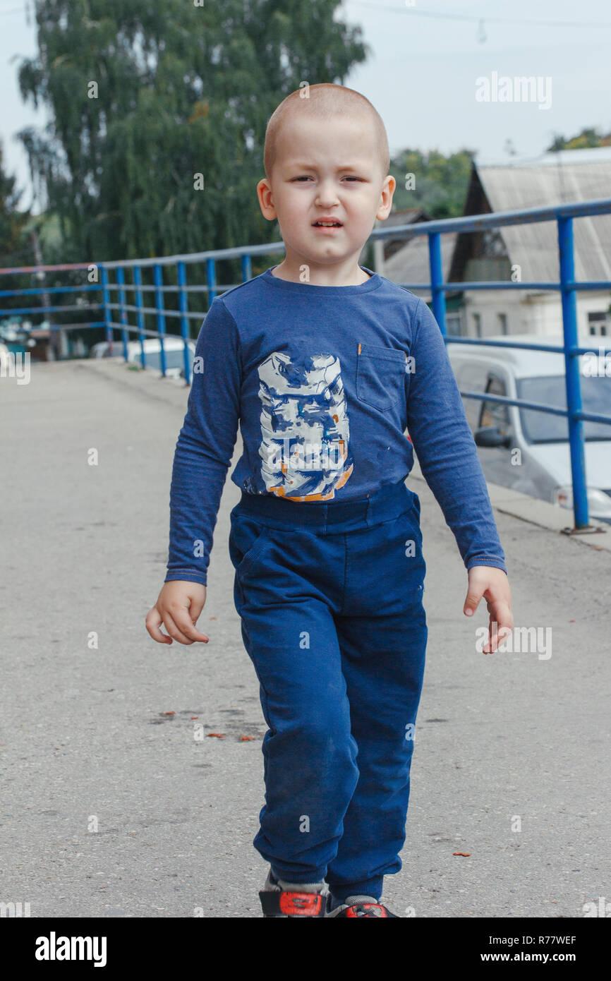 81dbcd94d0de Portrait of cute smiling little boy in blue shirt, outdoor shot ...