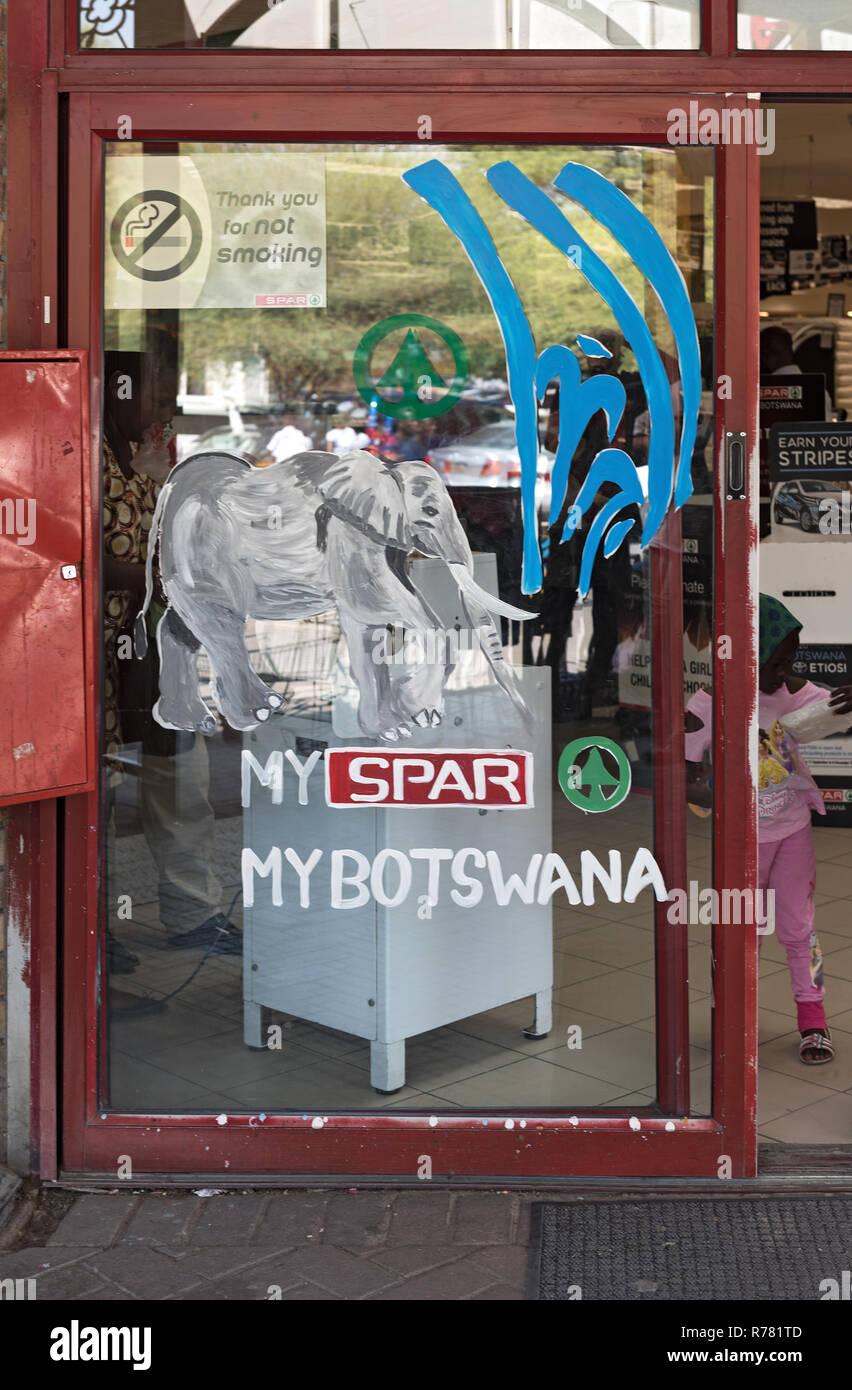 entrance door of a supermarket in maun, botswana - Stock Image
