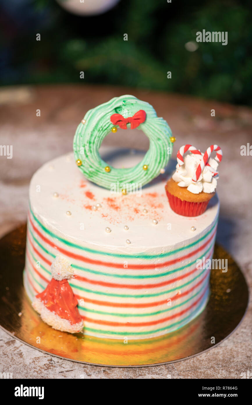 Christmas Cake Decorated With Christmas Cupcakes And Colorful Sweets