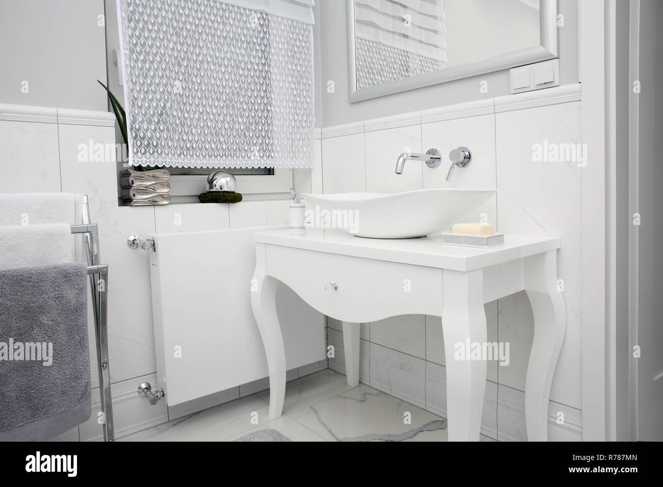 Bathroom in a beautiful style with marble tiles - Stock Image