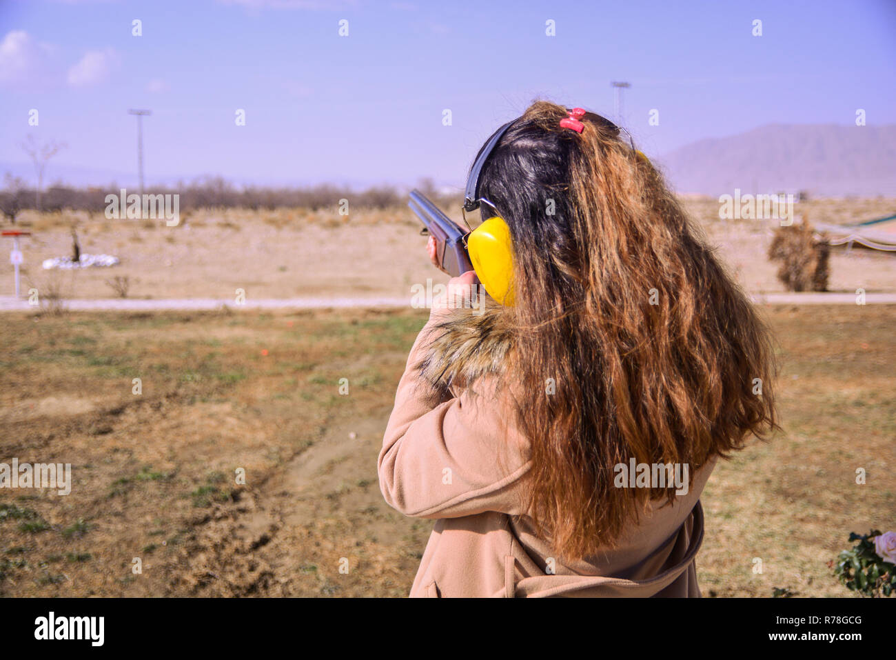 A girl firing with Skeet Gun - Stock Image