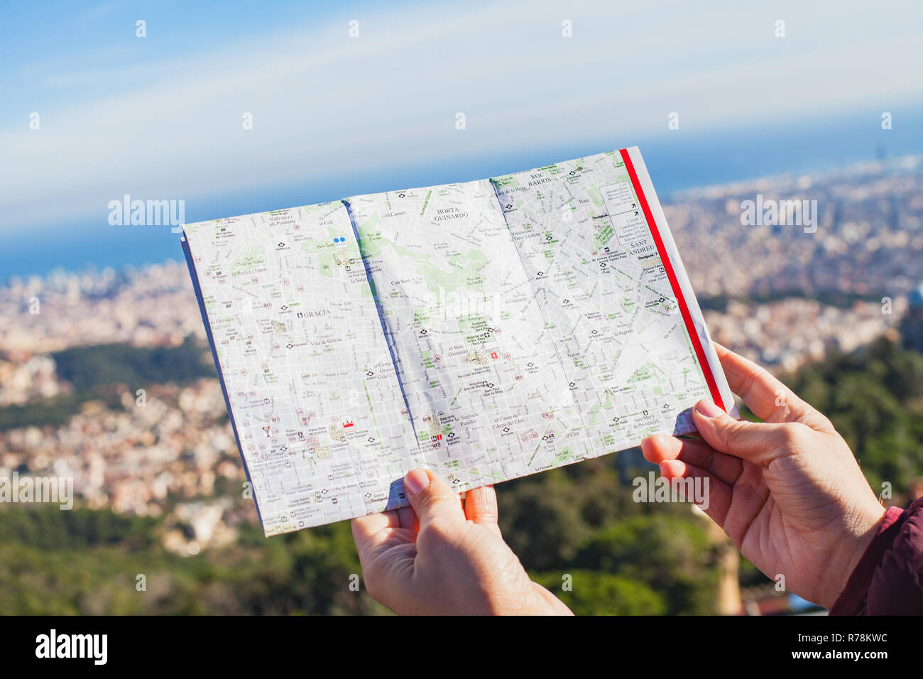 Female tourist searching for the right direction in the city map in ...