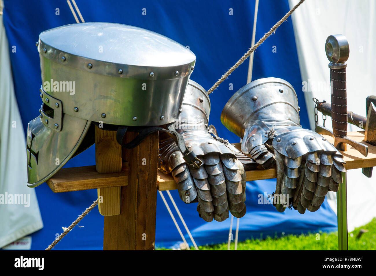 Medieval spectacle, helmet and gloves of a knight's armor, at Broich castle, Mülheim an der Ruhr, North Rhine-Westphalia Castle - Stock Image