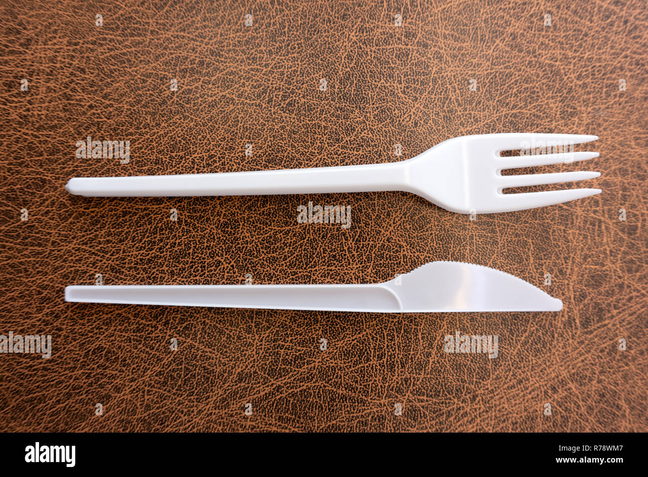 Plastic knife and fork isolated on white background - Stock Image