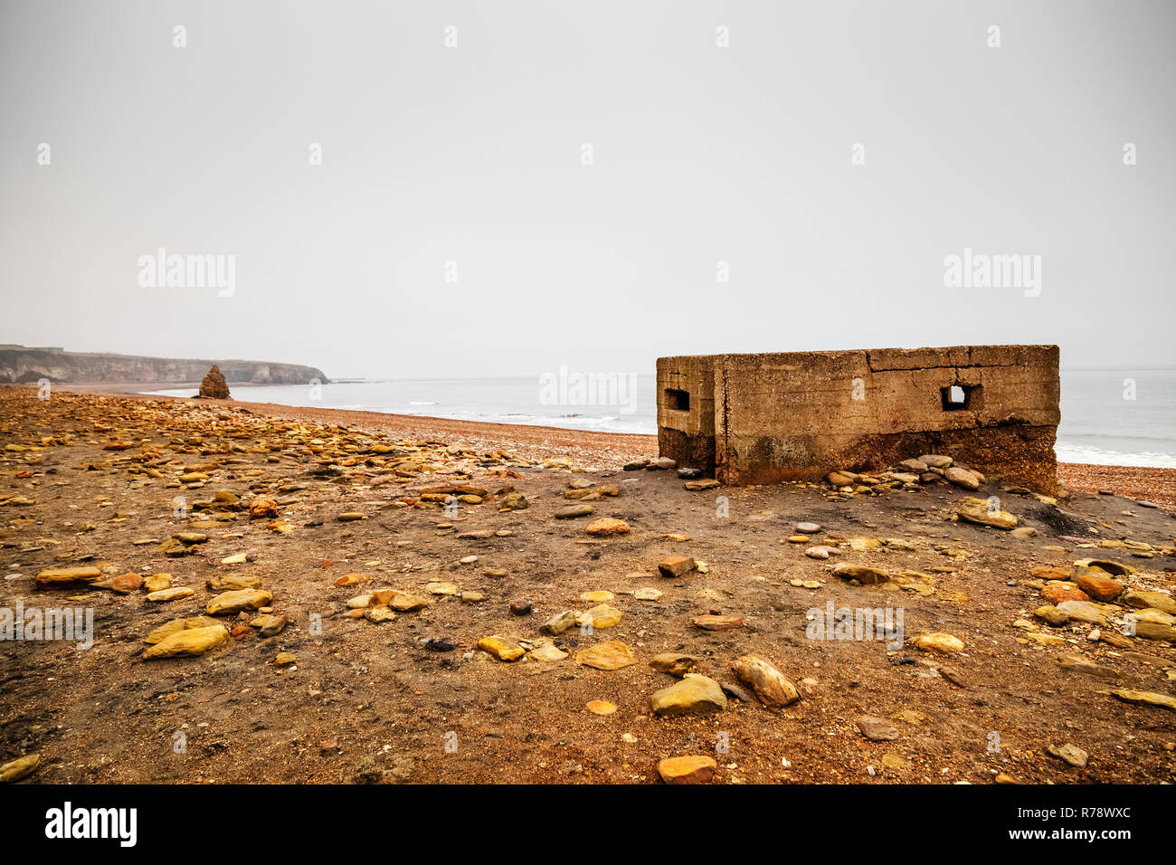 A World War 2 pill box on the coal waste polluted Blast Beach near Seaham, County Durham, UK - Stock Image