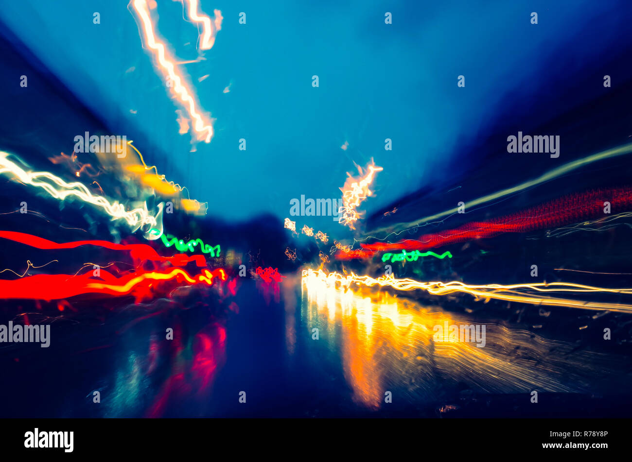 Light trails on a rainy evening in the city Stock Photo