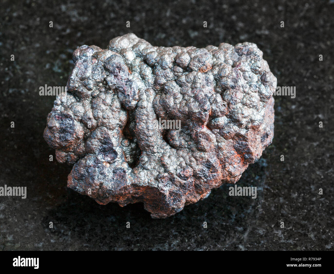 rough Goethite stone on black - Stock Image