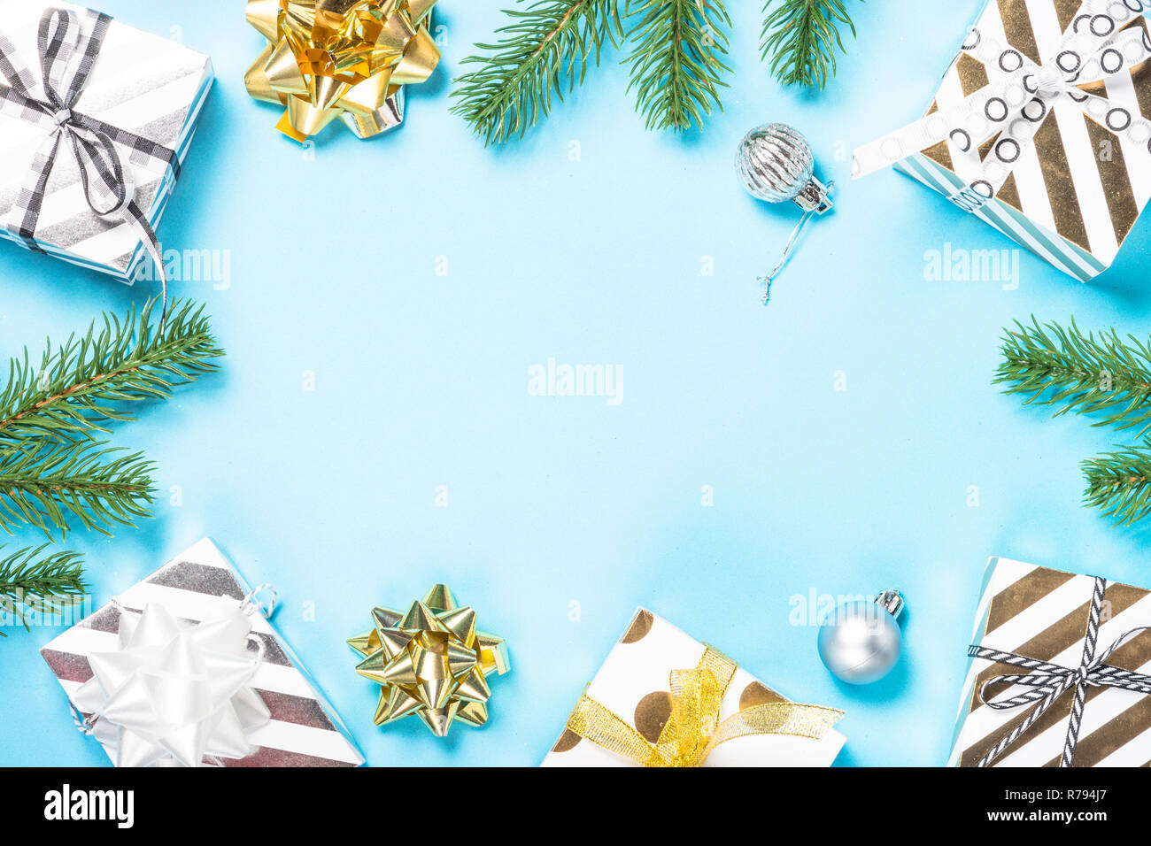 Christmas flatlay background - silver and gold decorations on bl - Stock Image
