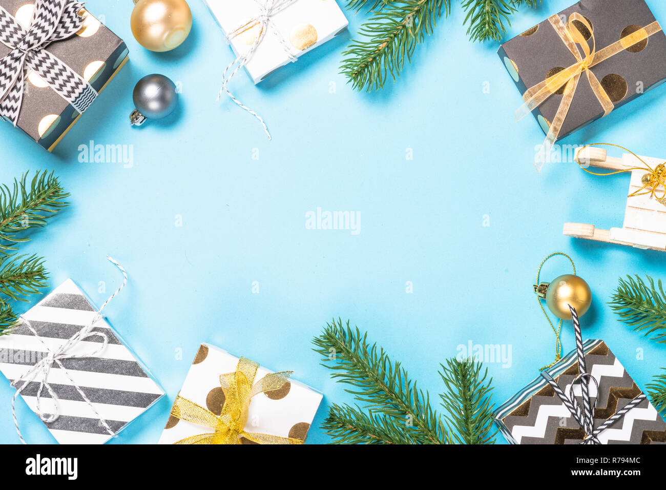 Christmas flatlay background - fir tree and decorations on blue  - Stock Image