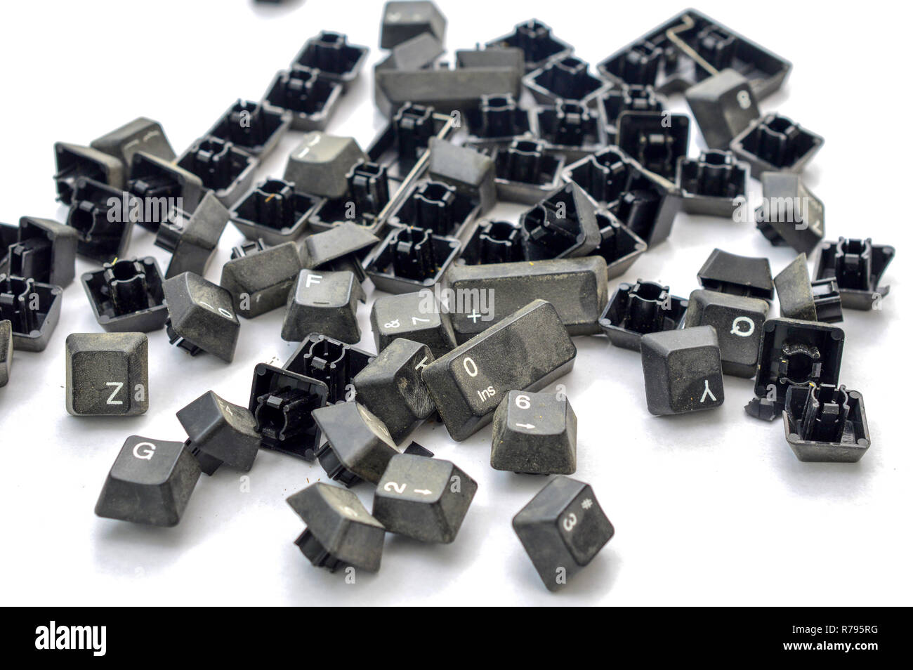 old dirty disassembled copmuter buttons on white background,image - Stock Image