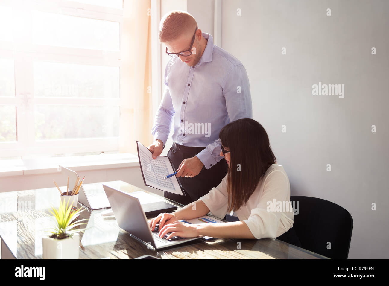 Businessman Showing Document To His Partner - Stock Image